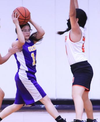 JADYN DOMINGUEZ looks for a teammate to pass the ball during the Nov. 16 game against McCamey. JACKIE VENEGAS | THE LION YEARBOOK