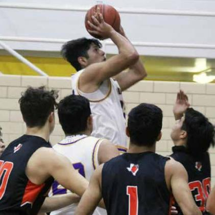 VARSITY LION EMMANUEL VENEGAS attempts a shot during Friday's game against McCamey at the OHS Davidson Gym. ALONDRA HERNANDEZ | THE LION YEARBOOK