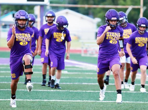 LION FOOTBALL PLAYERS Carlos Cantu (left) and Jose Dominguez run a drill during workouts Monday morning at Lion Stadium. MELISSA PERNER | THE OZONA STOCKMAN