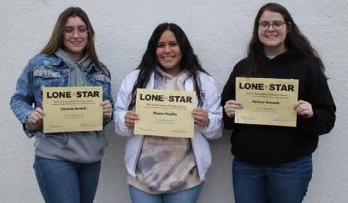 LION YEARBOOK STAFFERS (left to right) Victoria Nowell, Elyssa Trujillo and Sydney Knaack placed third in the Lone Star Writing Contest. MELISSA PERNER | THE OZONA STOCKMAN